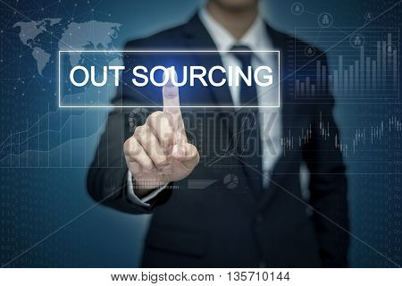 Businessman hand touching OUT SOURCING button on virtual screen