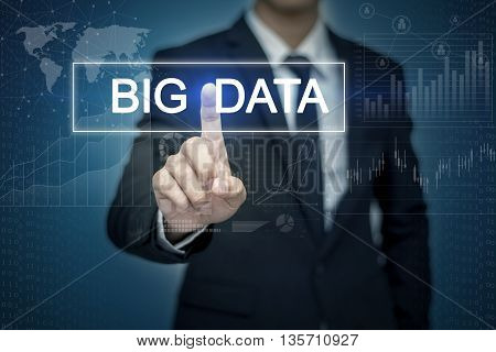 Businessman hand touching BIG DATA button on virtual screen