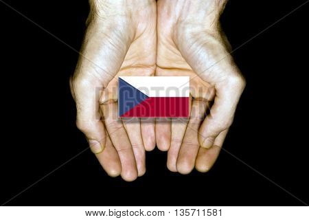 Flag Of Czech Republic In Hands On Black Background
