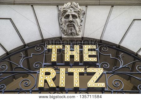 LONDON UK - MAY 7TH 2016: A sign above the entrance to The Ritz hotel on Piccadilly in central London on 7th May 2016. The Ritz is a famously luxurious 5 star hotel overlooking Green Park.
