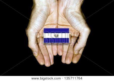 Flag Of El Salvador In Hands On Black Background