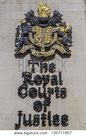 The sign next to the main entrance of the Royal Courts of Justice in central London.