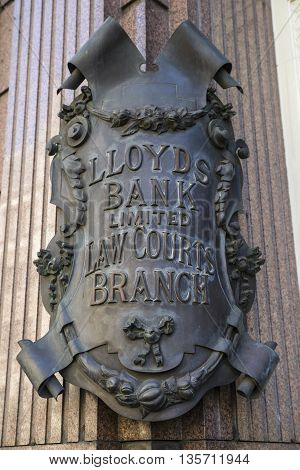LONDON UK - MAY 4TH 2016: The metal plaque outside the Law Courts branch of Lloyds Bank opposite the Royal Courts of Justice on the Strand in central London on 4th May 2016.