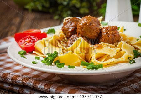 Tagliatelle, Meatballs In Dark Sauce And Tomato.