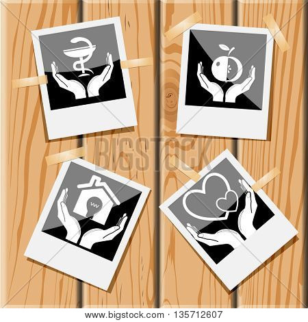 In hands set. Photo frames on wooden desk. Vector icons.
