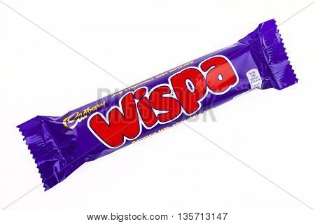 LONDON UK - MAY 6TH 2016: An unopened Wispa chocolate bar manufactured by Cadbury pictured over a plain white background on 6th May 2016.