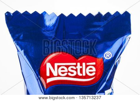 LONDON UK - MAY 6TH 2016: A close-up of the Nestle logo on one of their confectionery products pictured over a plain white background on 6th May 2016.