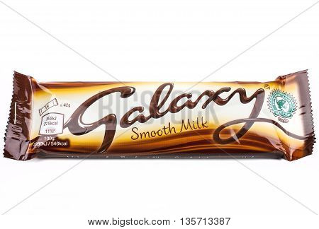 LONDON UK - MAY 6TH 2016: An unopened Galaxy chocolate bar manufactured by Mars Inc pictured over a plain white background on 6th May 2016.