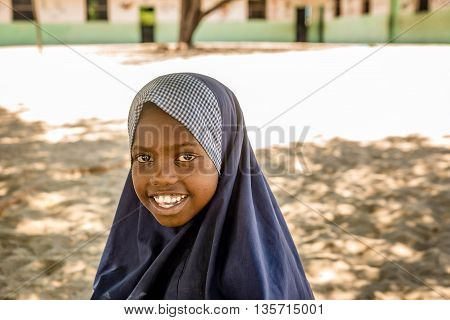 Mobmasa, Kenya- March 16,2016: School girl smiling in school uniform in Mombasa Kenya