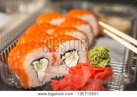 Philadelphia Roll In Disposable Plastic Food Container.