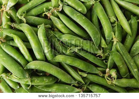 Green Pods With Peas As Background.