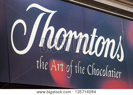 LONDON UK - APRIL 7TH 2016: A sign for a Thorntons retail store on Oxford Street in London on 7th April 2016.