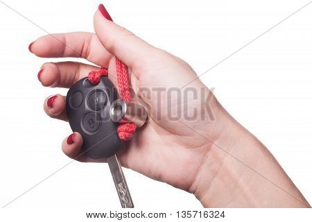 Close Up Of Hand Holding Car Key On White