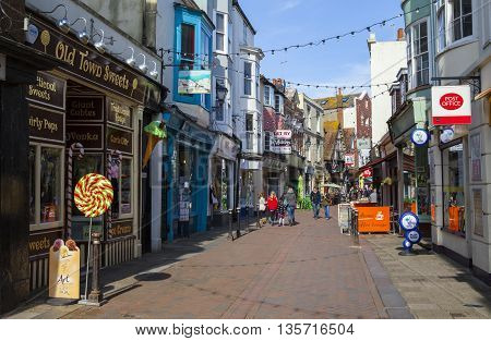 HASTINGS UK - APRIL 1ST 2016: A view down George Street - one of the streets in the old town area of Hastings in Sussex on 1st April 2016.