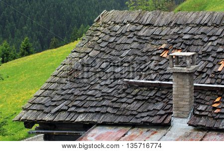 Roof Of Wooden Shingles And Stone Chimney