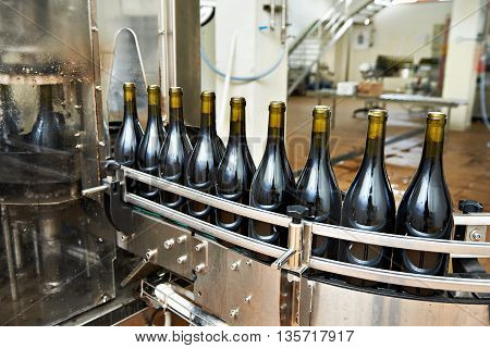 Bottling And Sealing Conveyor Line At Wine Factory