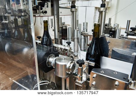 Labeling And Sealing Conveyor Line At Wine Factory