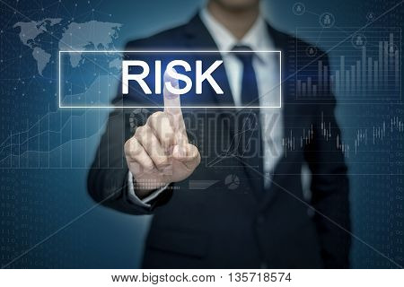 Businessman hand touching RISK button on virtual screen