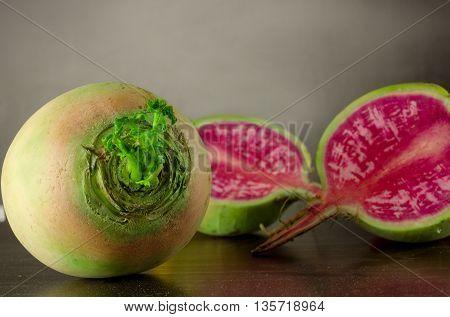 Fresh organic radishes on a black background