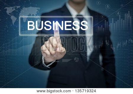 Businessman hand touching BUSINESS button on virtual screen