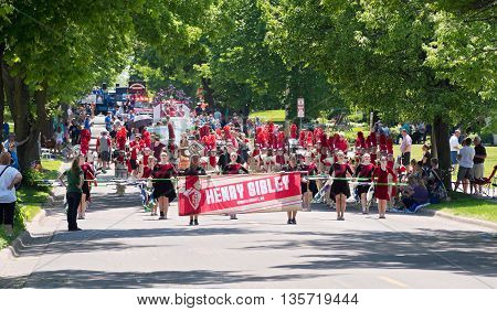 WEST ST. PAUL, MINNESOTA - MAY 21, 2016: Henry Sibley High School marching band proceeds up Smith Avenue during Grande Parade in West St. Paul on May 21.
