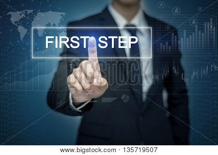 Businessman hand touching FIRST STEP button on virtual screen