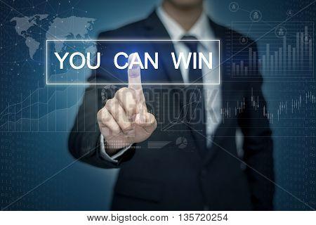 Businessman hand touching YOU CAN WIN button on virtual screen