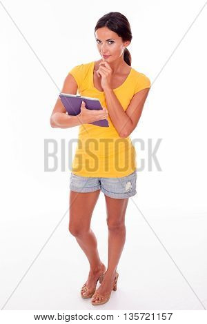 Thinking Young Brunette With A Tablet Pc
