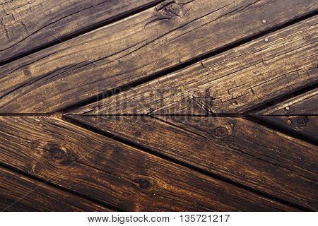 Close up top view of natural wood panel floor surface hipster style rustic background texture.