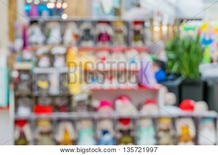 Shelves with goods in a supermarket. The interior of the store. Blur and defocus image as a background and postcard designs.