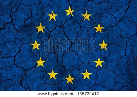 EU flag on racked background - EU failure concept  after Brexit