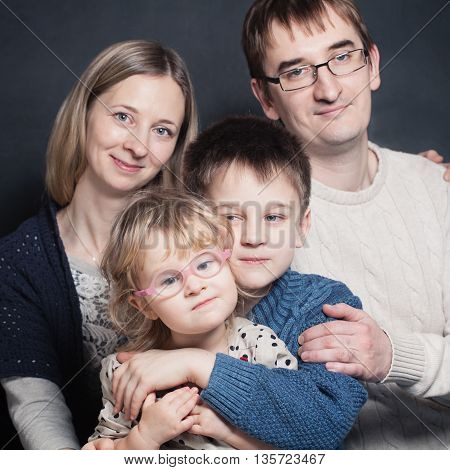 Little Children with Mother and Father. Family