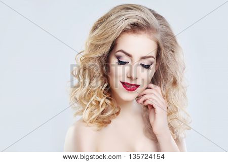 Blonde Hair Woman. Long Curly Hairstyle and Makeup