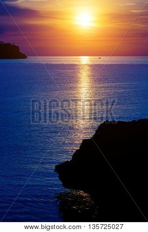 Sunset on the sea among the stone cliffs and islands