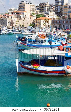 Heraklion old harbour with colorful boats, at sunny day, Crete, Greece
