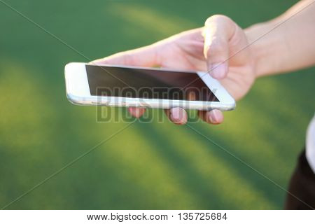 Hand holding and touch on smartphone screen