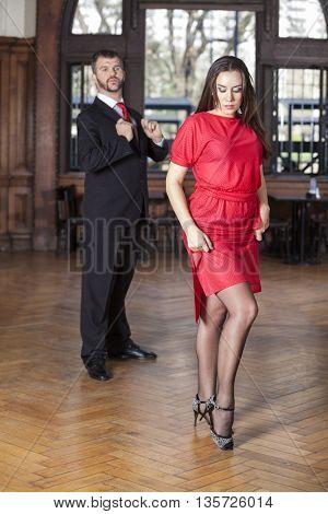 Woman Doing Tango Tap While Man Performing
