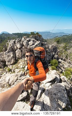 Help support and help in a dangerous situation to hike in the mountains.