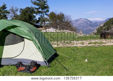 Camping with a view of the mountains in the summer on a sunny day.