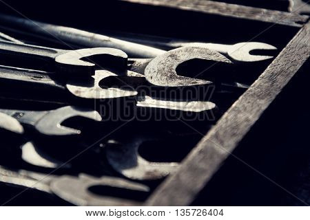 Loads Of Wrenches Or Spanners On A Colorful Wooden Background