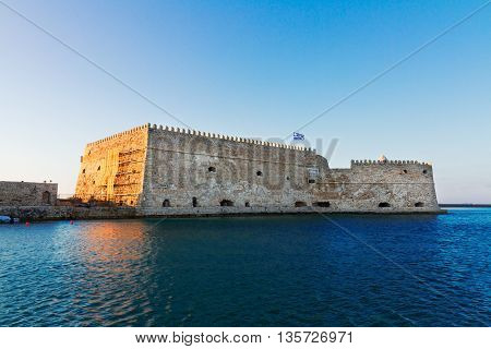 Heraklion old venetian bay with old venetian fort and boat, Crete, Greece