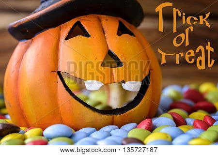 halloween pumpkin with chocolate candy and trick or treat written