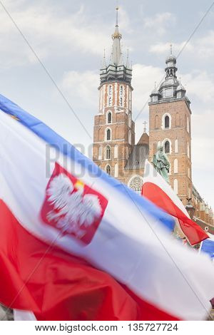 Poland Krakow Polish Flags foreground Towers of St Mary Church background demonstration