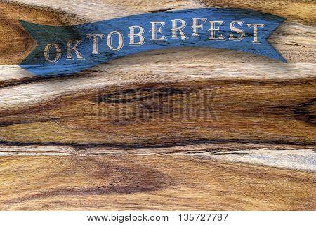 oktoberfest written blue ribbon on wooden background