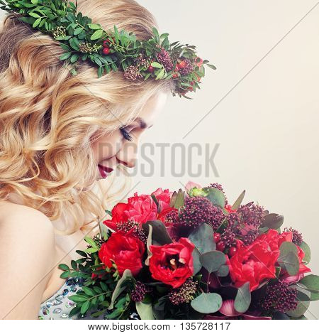beautiful Smiling Model Holding Flowers red Bouquet