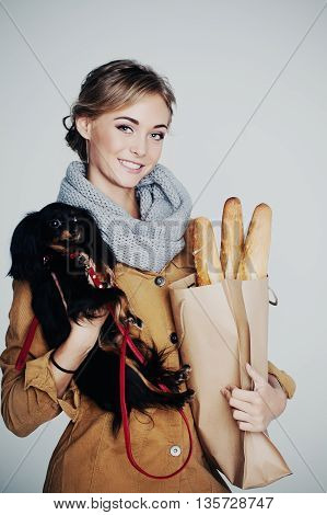 Young Woman Fashion Model. Girl Dog and Baguette