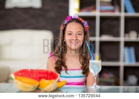 Summer refreshment. The girl drinking lemonade in front of her was watermelon and melon