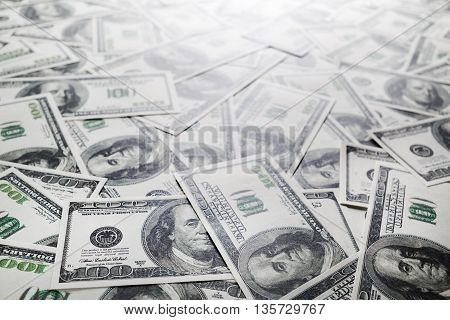 One hundred dollars pile. Money as background. Selective focus.