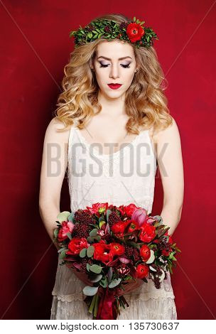 Beautiful Fiancee in White Dress and Flowers on Red Background