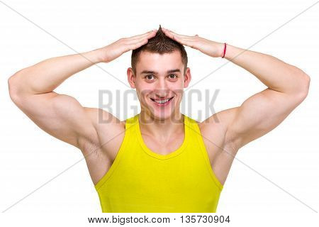 Sexy portrait of a young muscular male model with great happy smile against isolated white background